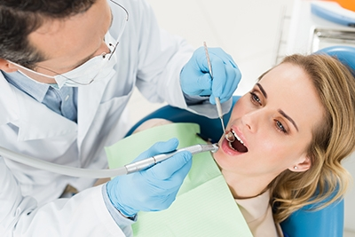 Photo of employee at dentist office using small business group health insurance in Connecticut